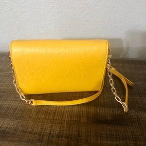 Tory Burch light yellow leather crossbody bag.